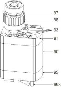拓朴:一种磁吸固定的无行程模内攻牙机